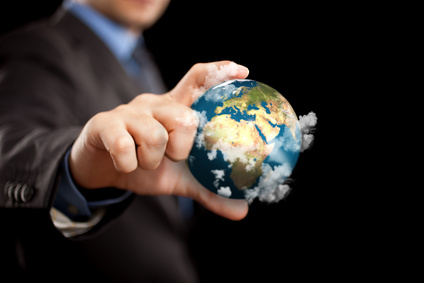 Businessman holding the world in the fingers